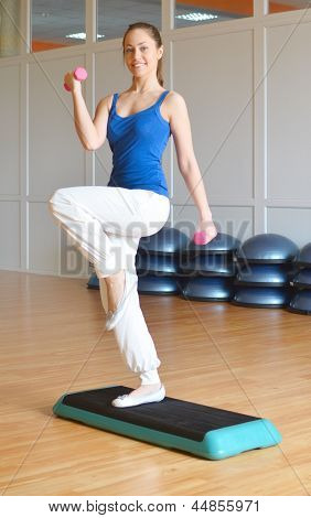 the pretty young woman doing an exercise stock photo