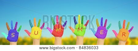 Kid\'s Painted Hands Against Blue Sky