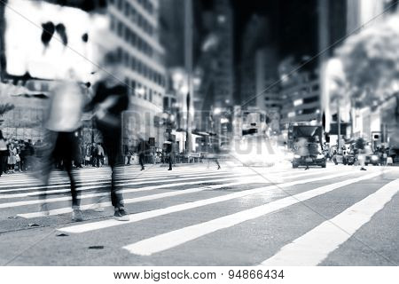 People Moving In Crowded Night City Street. Hong Kong