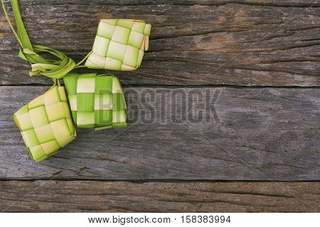 Ketupat (rice dumpling) is a local delicacy during the festive season in South East Asia. Ketupat a natural rice casing made from young coconut leaves for cooking rice.. stock photo