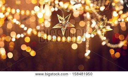 Christmas and New Year glowing Background with Holiday Decoration garland, tinsel and stars. Abstrac