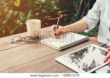 Young Business Woman Hand With Pencil Writing On Notebook. Woman Hand With Pencil Writing On Noteboo