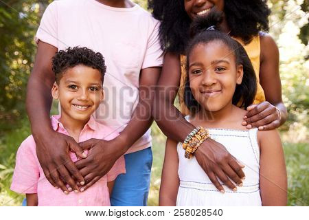 Mid section of black couple and their two children, portrait stock photo