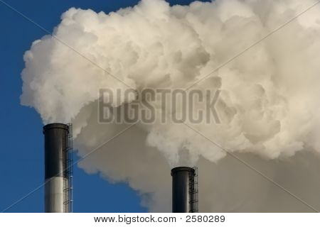 Coal plant emitting pollution. Burning coal is a leading cause of smog acid rain global warming and air toxics. In an average year a typical coal plant generates: 3700000 tons of carbon dioxide (co2) the primary human cause of global warming. stock photo