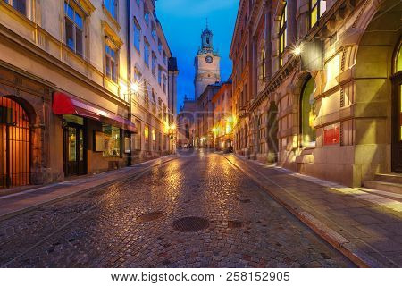 Church of St Nicholas, Stockholm Cathedral or Storkyrkan as viewed from Storkyrkobrinken street on the rainy night, Gamla Stan in Old Town of Stockholm, the capital of Sweden stock photo