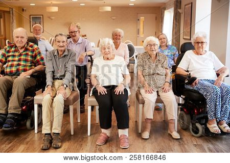 Group Of Seniors Enjoying Fitness Class In Retirement Home stock photo