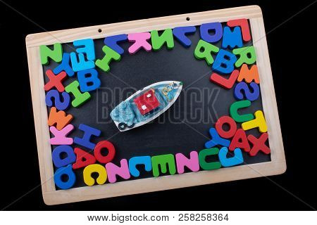 Model boat and Colorful wooden Letters of Alphabet stock photo