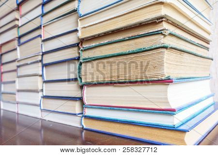 Stack of Used Old Books Background, Books of Different Thickness and Color, Many Books Piles in the