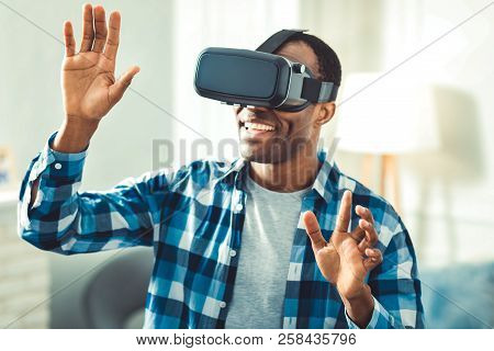 Happy afro american man using VR glasses stock photo