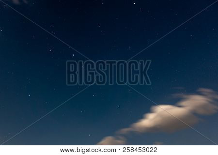 Ursa Major constellation in night sky with clouds stock photo