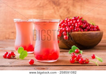 Cold compote made from fresh red currant berries. Boiled redcurrant juice. stock photo