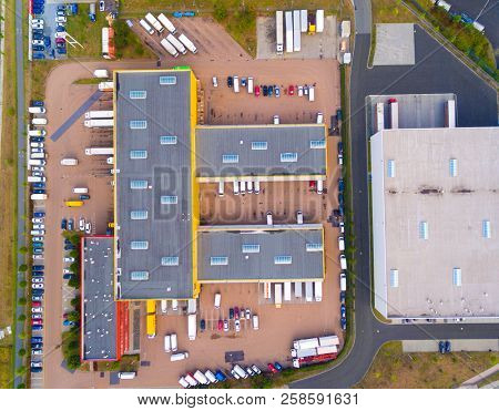 Aerial view of warehouse with trucks. Industrial background. Logistics from above.  stock photo