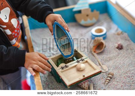 Autistic kid play alone with train toys stock photo
