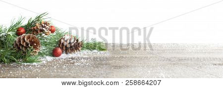 Christmas Card. Pine Cone And Green Branch On Wooden Table With Snow, Copy Space For Text, Isolated