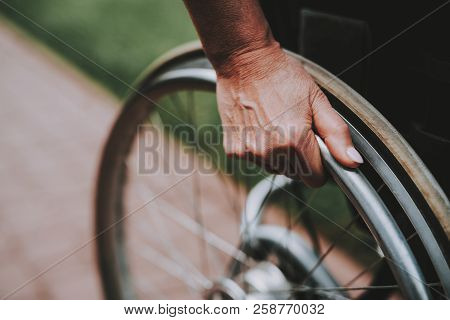 Patient Undergoes Rehabilitation. Cancer Patient on a Wheelchair. Woman with Daughter. Woman Glad See Daughter. Recovering Woman. Remission. Clinic. Cancer Patient. Hands Behind the Wheels. stock photo