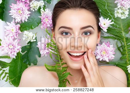 Portrait Of Young Sexy Beauty Female Woman Smiling With Clean Pure Skin Taking Spa Relaxing In Bath