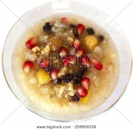 Turkish dessert Asure Ashure from the boiled cereals with dried fruits and pomegranate grains stock photo