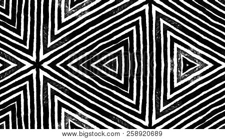 Dark black and white Geometric Watercolor. Decent Seamless Pattern. Hand Drawn Stripes. Brush Texture. Fantastic Chevron Ornament. Fabric Cloth Swimwear Design Wallpaper Wrapping. stock photo