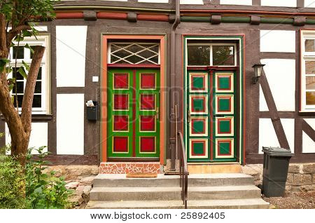 Colorful doors of half-timbered houses in Bavaria (Germany) stock photo