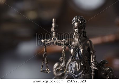 Justice concept. Statue of justice - Themis in the judge office. stock photo