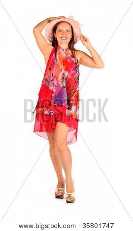 Happy woman dressed in bright pareo and hat poses in studio on white background. stock photo