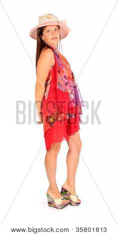 Fine woman dressed in bright pareo and hat poses in studio on white background. stock photo