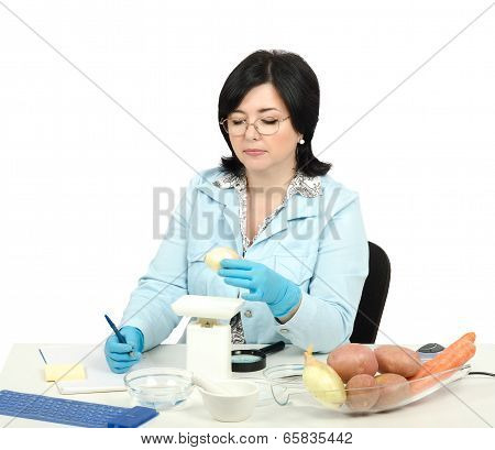 Expert weighing a bulb onion in phytosanitary laboratory stock photo