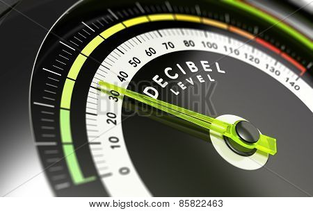 Decibel measurement. Gauge with green needle pointing 30 dB concept of noise reduction stock photo