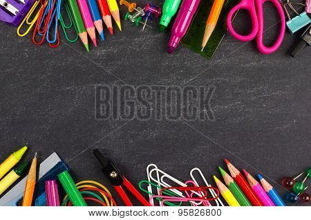 Chalkboard with school supplies outline