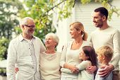 family, bliss, era, home and individuals idea - glad family remaining before house out