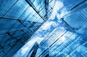 Modern business high rises, elevated structures, building design raising to the sky, sun. Ideas of