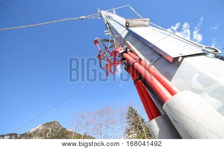 iron pole of an electrical system with cables and high voltage insulators of a voltage transformer stock photo