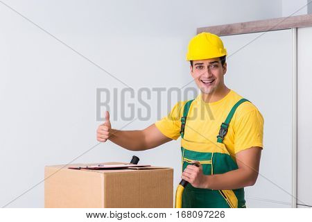 Transportation worker delivering boxes to house stock photo