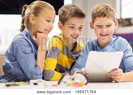 education, science, technology, children and people concept - group of happy kids or students with t