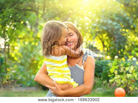 Beautiful Mother And her little daughter outdoors. Nature. Beauty Mum and her Child playing in Park