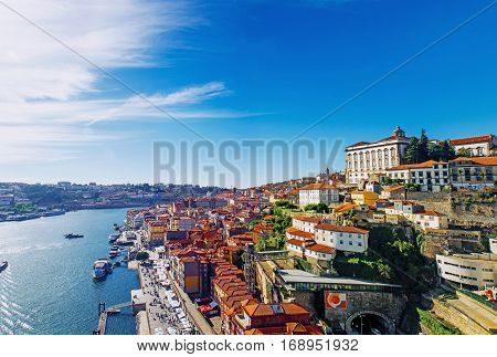 Porto Portugal old town skyline from Dom Luis bridge on the Douro River.