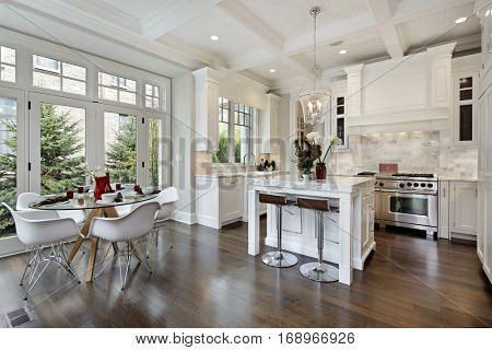 Kitchen in luxury home with white cabinetry.
