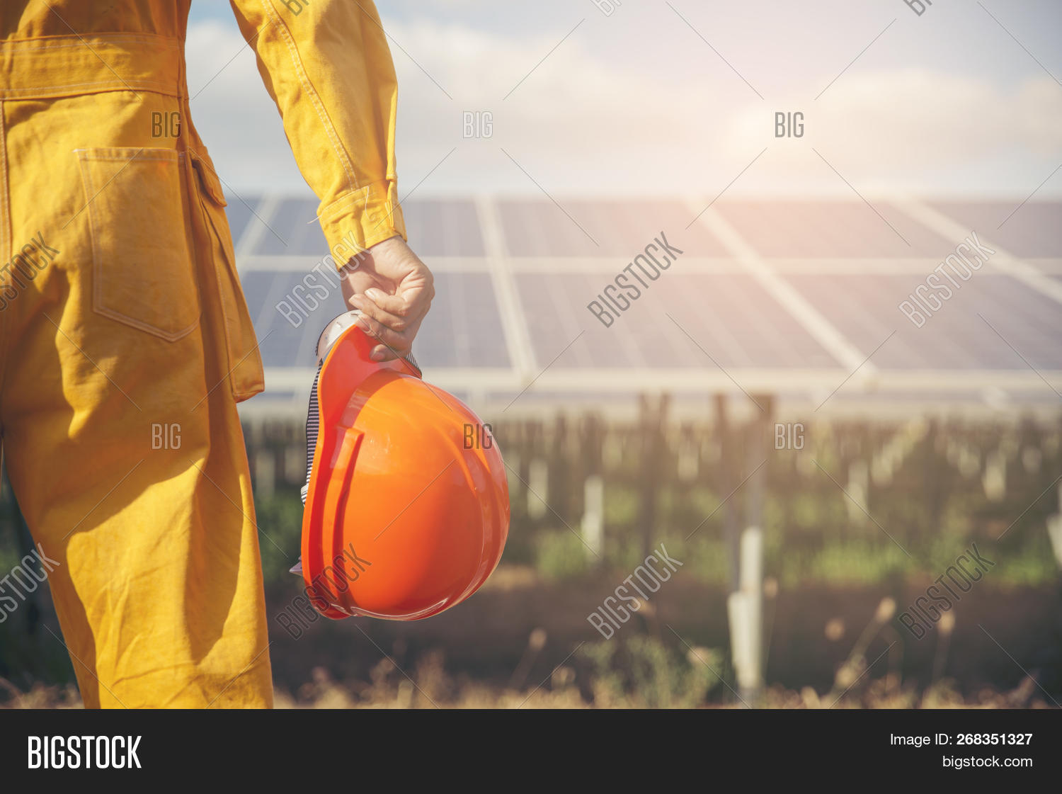 background,building,business,clean,concept,construction,contractor,electrical,employee,energy,engineer,environment,equipment,foreman,green,hard,hardhat,hat,health,helmet,holding,industrial,industry,job,labor,looking,male,men,occupation,officer,orange,panel,people,person,plant,power,professional,project,protection,safety,site,solar,suit,sustainable,technician,technology,wearing,work,worker