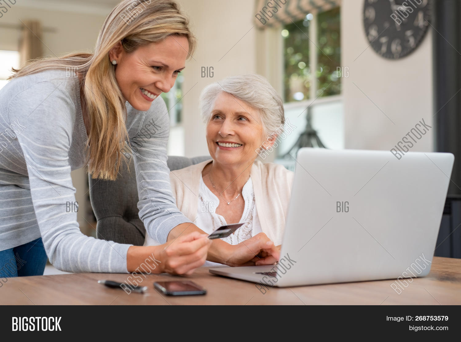 aging process,assistance,banking,bill,bills,buy,card,computer,connection,credit,credit card,customer,daughter,ecommerce,elderly care,elderly woman,happy,helping hand,holding,home,internet,internet banking,laptop,mature,mother,mother and daughter,old,old age,old woman,online,online shop,online shopping,pay,paying,paying with credit card,payment,people,purchase,retired,retired woman,retirement,senior,shop,shopping online,technology,using computer,using laptop,web,wireless,woman