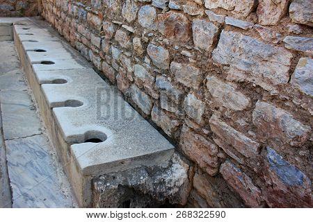 Public toilet from ancient Roman times Ephesus, Turkey stock photo