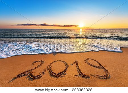 Number 2019 Written On Seashore Sand At Sunrise. Happy New Year 2019 Concept.