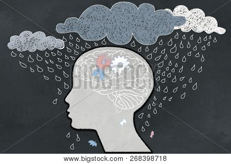 Depression Concept with Heavy Rain directly aimed at depressive Human Profile with a broken Brain. Illustrated with Chalk on Blackboard stock photo