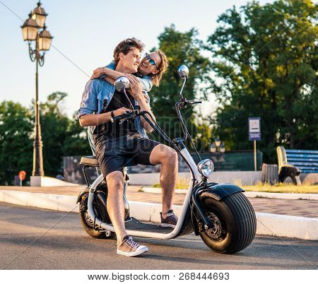 Lovely young couple dating with electric bike. stock photo