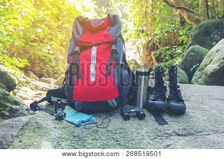 Hiking Travel Gear On Glasses. Items Include Hiking Boots, Cup, Map,binoculars. Flat Lay Of Outdoor