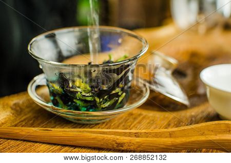 Organic blue tea Anchan in a teapot and a cups on wooden background stock photo