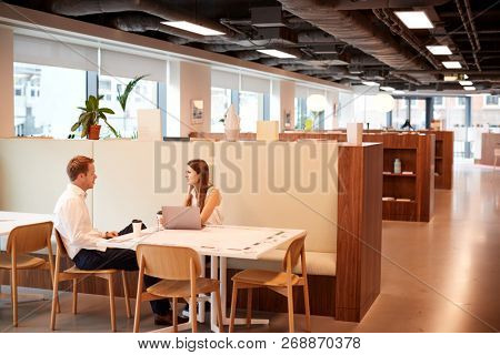 Young Businessman Having Informal Interview In Cafeteria Area At Graduate Recruitment Assessment Day stock photo