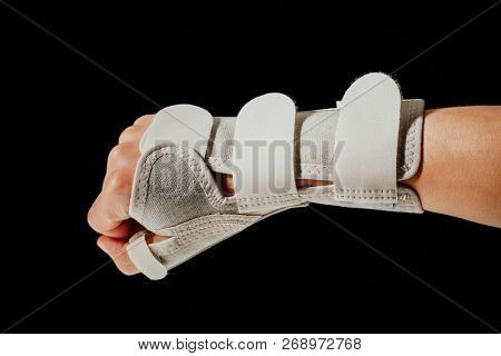 wrist and hand orthotics support for carpal tunnel syndrome healing, isolated on black stock photo
