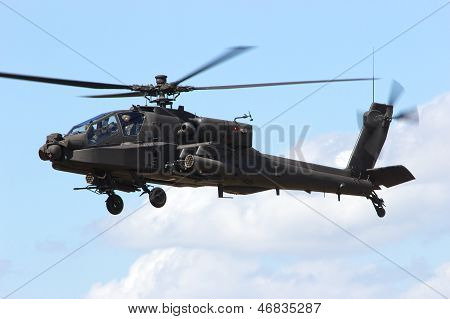 An armed army attack helicopter hovering above ground stock photo