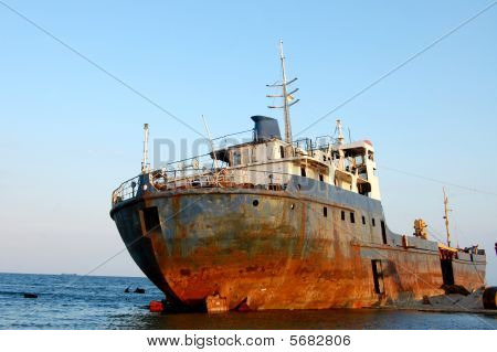 A big rusty trawler wreck at the seaside of the Black sea stock photo