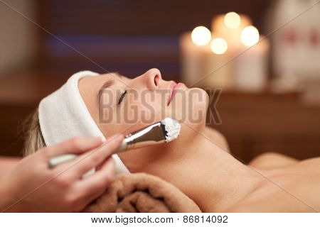 people, beauty, spa, cosmetology and skincare concept - close up of beautiful young woman lying with